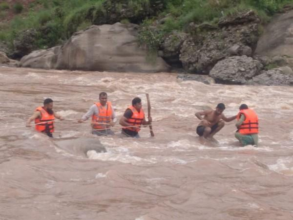 Visual from the rescue of a minor in a flash flood in Udhampur. (Photo/ANI)
