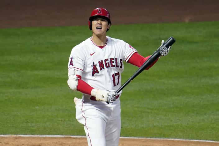 Los Angeles Angels' Shohei Ohtani reacts as he hits a foul ball during the third inning of a baseball game against the Tampa Bay Rays Monday, May 3, 2021, in Anaheim, Calif. (AP Photo/Marcio Jose Sanchez)