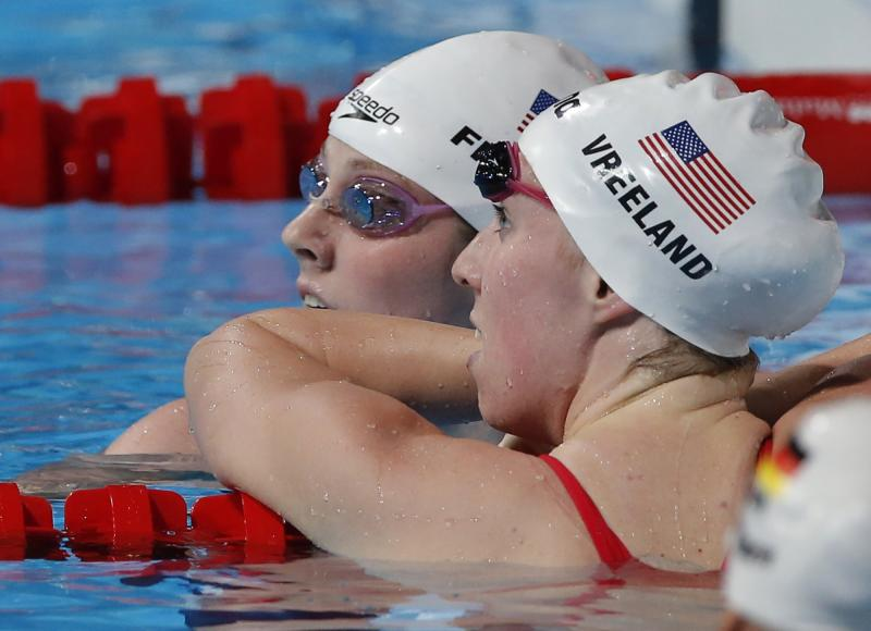 Missy Franklin of the United States, left, and United States's Shannon Vreeland rest after finishing a Women's 100m freestyle heat at the FINA Swimming World Championships in Barcelona, Spain, Thursday, Aug. 1, 2013. (AP Photo/Daniel Ochoa de Olza)