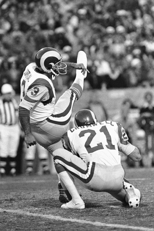 FILE - In this Jan. 7, 1980, file photo, Frank Corral (3) of the Los Angeles Rams, kicks his third and final field goal against the Tampa Bay Buccaneers in the NFC Championship NFL football game in Tampa, Fla. Holding is Nolan Cromwell (21). Los Angeles beat Tampa 9-0 on three field goals. (AP Photo/File)