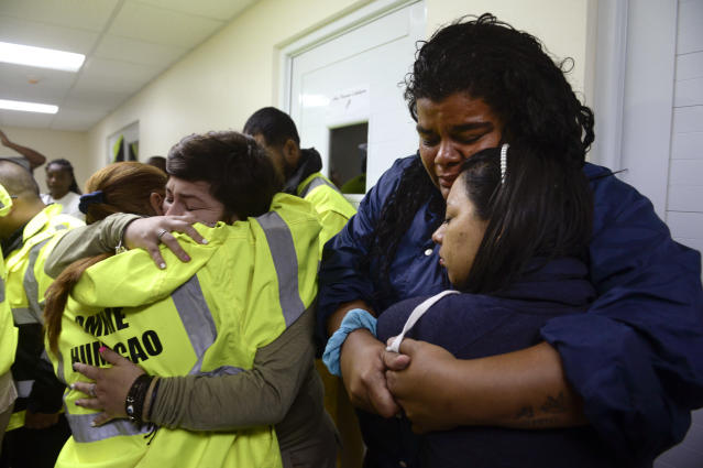 <p>Rescue team members Candida Lozada, left, and Stephanie Rivera, second from left, Mary Rodriguez, second from right, and Zuly Ruiz, right, embrace as they wait to assist in the aftermath of Hurricane Maria in Humacao, Puerto Rico, Wednesday, Sept. 20, 2017. (Photo: Carlos Giusti/AP) </p>