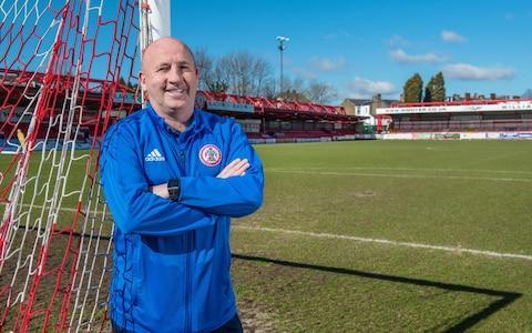 "As seasonal bonuses go, John Coleman is poised on the brink of a rather unusual one. If he gains promotion to League One with his high-flying Accrington Stanley side, a local hair replacement clinic has promised to give him a celebratory new thatch. ""I thought it was a joke, but apparently they mean it,"" the long-time entirely hair-free Coleman says of the incentive. ""Not sure what the lads will make of it, mind, if I suddenly go full [Antonio] Conte on them."" Before he emerges with a luxuriant new coiffure, Coleman, however, might be wise to check with the Football League that he is not breaching any of its regulations on undisclosed rewards. After all, the governing body has just demanded the club's chairman, Andy Holt, explain what he was doing after he revealed this week that he had been buying the team a round of McDonald's after every victory this season. Which, given they have won 16 of their past 18 League Two matches, has come to quite a burger bill. The EFL's prissy intervention has been roundly mocked, with many wondering how a body that has allowed all sorts of charlatans and frauds to take control of its clubs can apparently sniff impropriety in the purchase of a few Big Macs. Not that Coleman seems remotely perturbed by the official inquiry. ""If they've won, they can eat pizza, chicken whatever they want as far as I'm concerned,"" he says of his players. ""If the lads want to eat McDonald's and the chairman wants to buy it for them, I'm certainly not going to stop them."" Accrington have won 16 of their last 18 games under Coleman Credit: REX But there is something wonderfully Accrington about the story. Of all the clubs that might choose to celebrate a win in fast food, Stanley is the one. This is not a place that exudes wealth. This is not a club that wallows in privilege. This is a club where everything is modest, from the cramped board room in which Coleman sits, to the fact the players have to warm up before training on a gravel patch behind the car park. This is a club, after all, whose two most renowned ex-players became famous doing something else: cricketer David ""Bumble"" Lloyd and Jon Anderson, the lead singer of prog-rockers Yes, played together in Stanley's amateur Northern League days. But all that may well be about to change. Since the club – or at least its previous incarnation – entered the league in 1921, before resigning midway through the 1962 season, going bust and then reforming in 1968, it has never played above the fourth tier of English football. Coleman is thus on the verge of achieving a remarkable first. The prospect of creating history, however, is not being discussed in the Wham Stadium (named after Holt's plastics company, not George Michael's first band). Here in this former pub pitch behind the Crown public house, despite the fact the team has embarked on a winning league run which is the third best in Europe after Juventus and Paris St Germain, caution is at all times the manager's watchword. ""I'll believe it when and only when it's mathematically certain,"" says Coleman. His restraint is understandable. After all he has first-hand knowledge of disappointment. After steering the club to three promotions through the non-leagues in his two spells in charge, in 2016 he looked as if he were about to hit the big time. Coleman is not looking beyond Stanley's next match Credit: THE TELEGRAPH Right up until the last moment of the final fixture of that season, his Accrington side appeared to be in line for automatic promotion to League One. ""In the 93rd minute we're up, in the 94th we hit the crossbar,"" Coleman recalls. ""Then in the 95th minute Bristol Rovers score in their game and that's it we're not going up, they are. It was the only game all season we didn't score at home."" An exhausted Accrington subsequently stumbled in the play-offs. And that seemed to be that. The club with the lowest playing budget and lowest gates in the league appeared to have blown a once-in-a-generation chance to progress. Particularly when finances dictated that its best two players – Josh Windass and Matt Crooks – were sold to Rangers. But Coleman regrouped. ""The pain of that day has driven me on,"" he says. ""I still haven't got over it to be honest."" And after finishing 16th last season, he has turned his team this year into a rolling victory machine, three points clear at the top of the table with two games in hand over second-placed Luton Town. It has been done, he says, not as a result of any magical increase in the budget, but by recruiting hungry young players keen to use Accrington as a staging post to a more substantial career. ""If our chairman said go sign five players tomorrow on five grand a week, it wouldn't fit my model. They wouldn't be signing for Accrington, they'd be signing for the money, not to further their careers. I want players who eventually want to earn £20,000 but not with me. ""Too many League Two teams pay ridiculous money they don't need to. They're spending money that's killing the hunger."" Coleman wants his players to enjoy their football - but work hard in the process Credit: THE TELEGRAPH And when players – such as the division's leading scorer Billy Kee, or the fluent midfielder Sean McConville – arrive in east Lancashire, they find Coleman drives them hard. ""I think we're the fittest team in the division,"" he says. ""But we have fun doing it. It's not a holiday camp, but I'm of the view you'll do the job better if you're enjoying it."" The evidence for their stamina is evident, he adds, in the fact he has not made a substitution in the last six league games. ""I'm of the opinion if it ain't broke don't fix it,"" he says. ""Course it helps if you're winning. Don't need to change anything do you?"" And as he prepares to play Colchester in what could be another huge step towards history, the ebullient Scouser takes a moment to consider what promotion would mean to the club. ""Even before I came I always had a fascination with this club, the milk advert and all that. I've been here nearly 20 years, it's been like watching a child grow. We were in the first division of the Unibond when I started. Now we could soon be in League One."" Though he immediately checks himself at the very thought. ""But I won't count my chickens until we're there. I've been here before. We got to 94 minutes of the last game thinking we were there. And we weren't. Worth remembering that."""