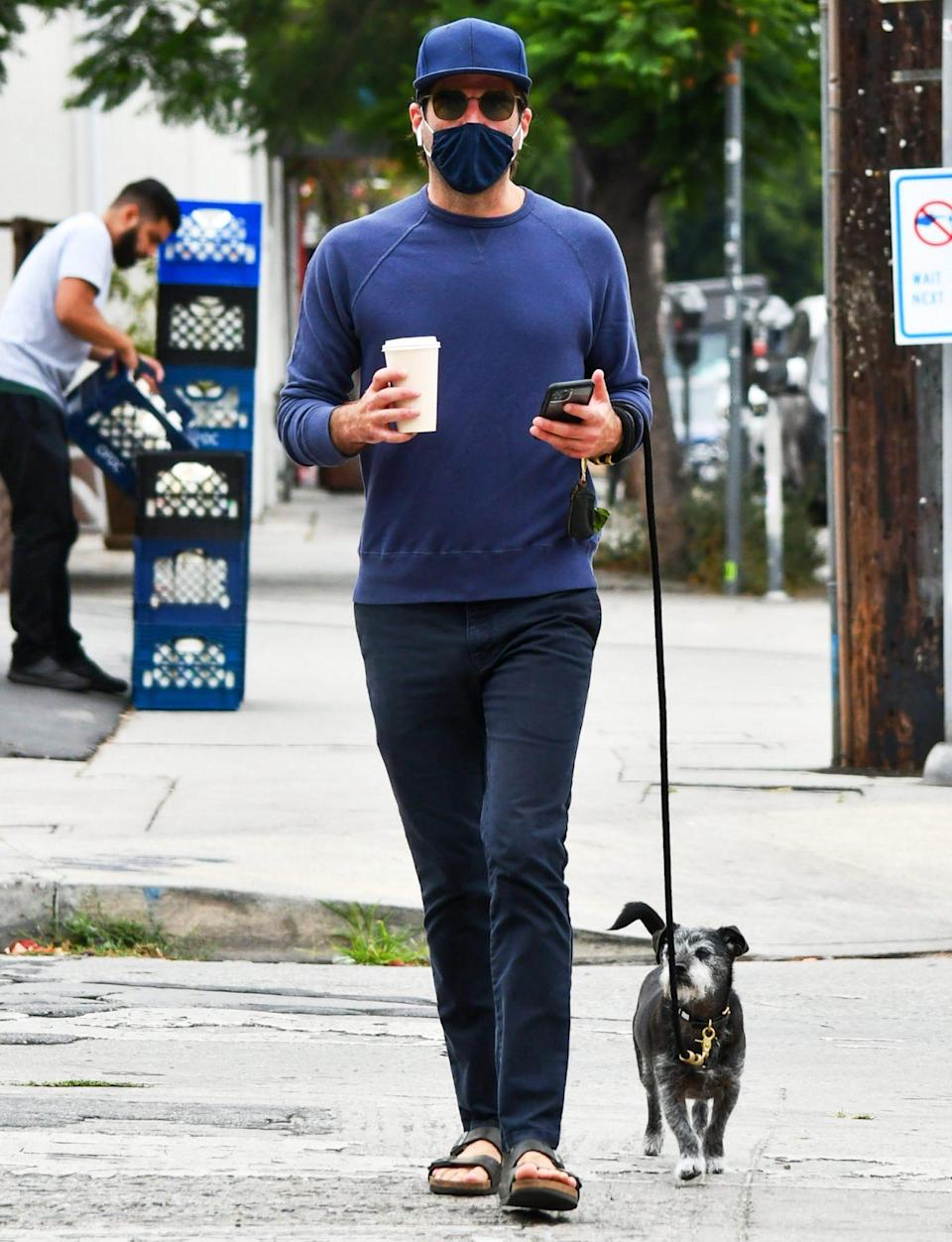 <p>Zachary Quinto and his pup go out for a stroll in L.A. on Wednesday.</p>