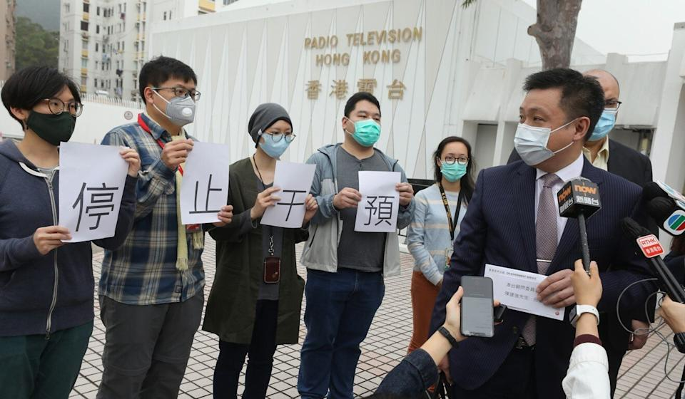 Dr Eugene Chan, chairman of RTHK's Board of Advisors receives a letter from staff calling for intervention in their editorial decisions to stop outside the broadcaster's headquarters in March. Photo: Dickson Lee