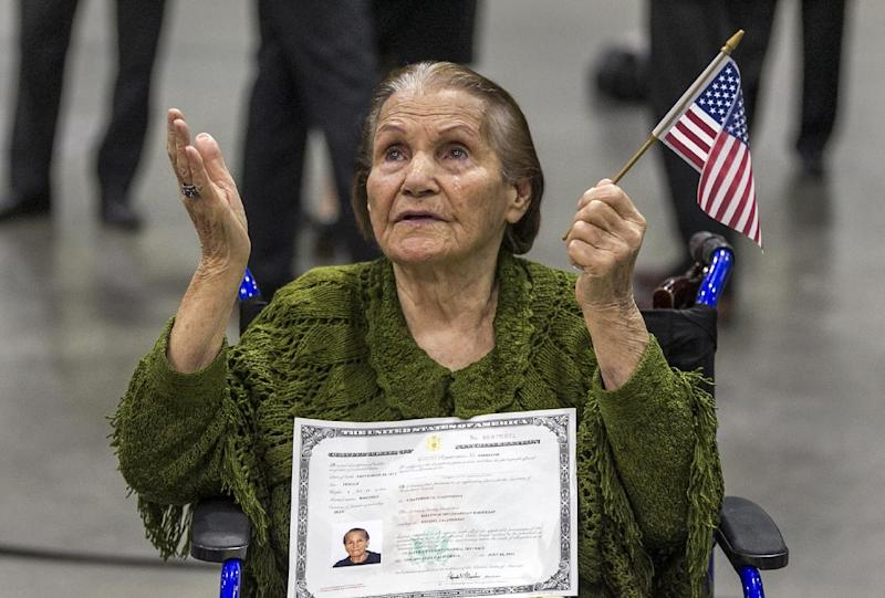 New American Khatoun Novasartian Khoykani, a 99-year-old woman from Iran cries as she joins nearly 7,500 people becoming U.S. Citizens at the L.A. Convention Center in Los Angeles Friday, July 26, 2013. On Friday, Khoykani became the oldest person this year to join the small group of naturalized citizens over the age of 95. Each year, less than ten people older than 95 become citizens in Los Angeles, according to U.S. Citizenship and Immigration Services. Only 27 people older than 100 have become citizens in the past 50 years.(AP Photo/Damian Dovarganes)