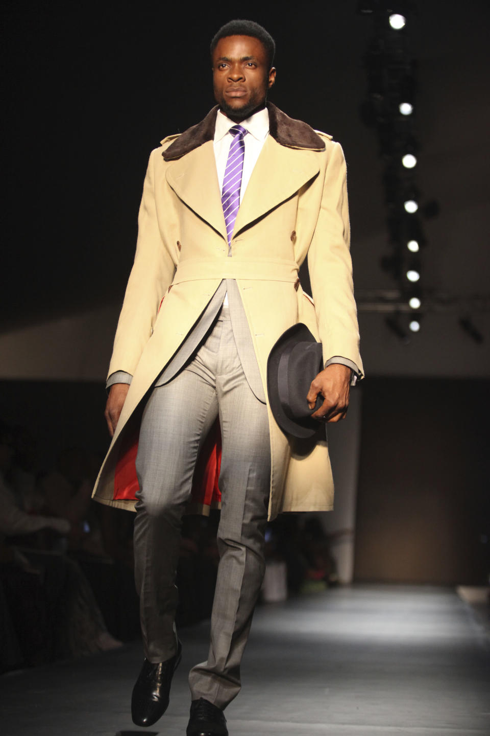A model displays an outfit during the ARISE Fashion Week event in Lagos, Nigeria on Sunday, March 11, 2012. (AP Photos/Sunday Alamba)