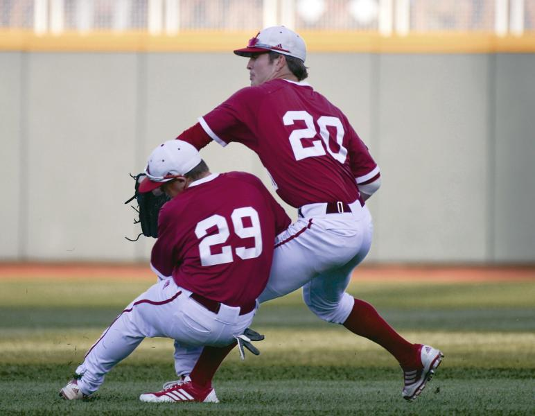 Indiana second baseman Chad Clark (29) and right fielder Casey Smith collide as Smith catches a fly ball hit by Oregon State's Jeff Hendrix in the second inning of an NCAA College World Series elimination baseball game in Omaha, Neb., Wednesday, June 19, 2013. (AP Photo/Ted Kirk)