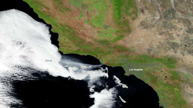 The Suomi NPP satellite passed over the blaze on May 2, 2013 around 21:30 Z, capturing this high resolution imagery with its visible and infrared energy sensors. A stream of smoke is clearly visible moving west over the ocean, as are the heat signatures from the active fires areas. (NASA/NOAA)