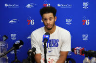 Philadelphia 76ers' Seth Curry listens to a question while speaking with the media at the team's NBA basketball practice facility, Wednesday, Oct. 13, 2021, in Camden, N.J. (AP Photo/Matt Slocum)