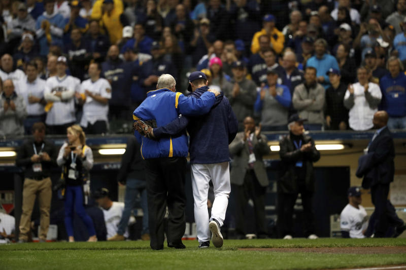 Former Commissioner of Baseball Bud Selig, left, walks off the mound with Milwaukee Brewers manager Craig Counsell after throwing a ceremonial first pitch before Game 6 of the National League Championship Series baseball game between the Milwaukee Brewers and the Los Angeles Dodgers Friday, Oct. 19, 2018, in Milwaukee. (AP Photo/Jeff Roberson)