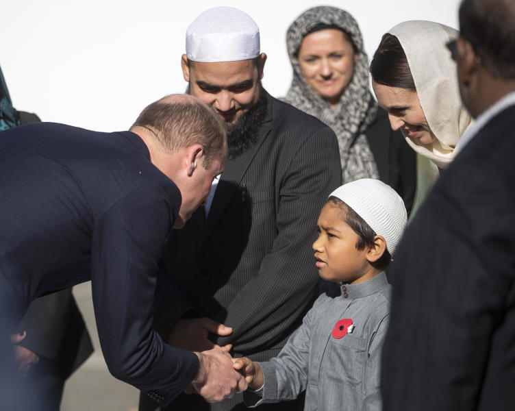 Britain's Prince William, left, meets a young Muslim community member and New Zealand Prime Minister Jacinda Ardern, second right, at the Al Noor mosque during a visit to the mosque in Christchurch, New Zealand, Friday, April 26, 2019. Prince William visited the one of the mosques where 50 people were killed and 50 others wounded in a March 15 attack by a white supremacist. (Joseph Johnson/Pool via AP)