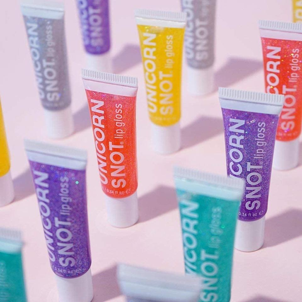 <p>They'll love topping up their lips with this <span>Unicorn Snot Holographic Glitter Lip Gloss Set</span> ($24 for five). It comes in pink, blue, purple, silver and gold.</p>