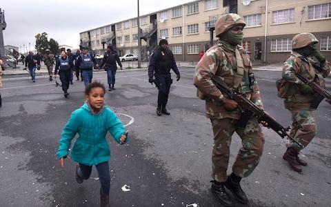 Soldiers patrol in Hanover Park, a notoriously violent township, on Thursday July 18 - Credit: The Telegraph/Brenton Geach