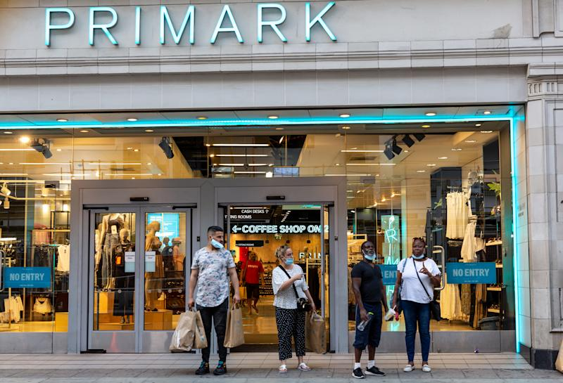 Shoppers stand in front of the Primark shop window at Oxford Street as Coronavirus lockdown eases in London, England, United Kingdomon, August 11, 2020. Lockdown forced many retailers to limit operations of its high street shops. (Photo by Dominika Zarzycka/NurPhoto via Getty Images)