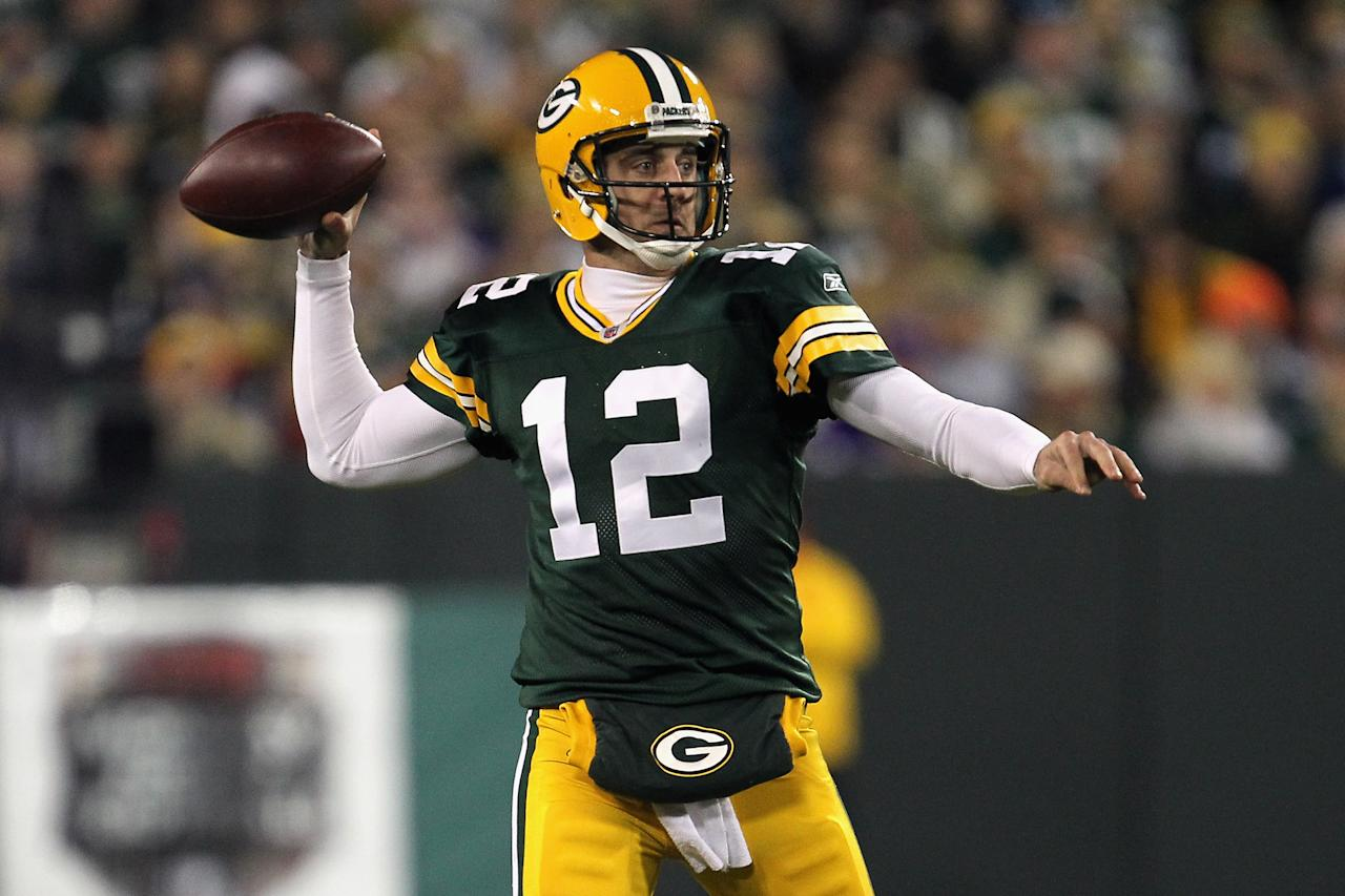 GREEN BAY, WI - NOVEMBER 14:  Aaron Rodgers #12 of the Green Bay Packers throws a pass against the Minnesota Vikings at Lambeau Field on November 14, 2011 in Green Bay, Wisconsin.  (Photo by Jonathan Daniel/Getty Images)