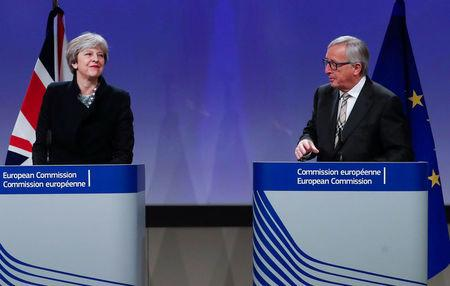 Britain's PM May and EU Commission President Juncker leave after making statements at the European Commission in Brussels