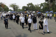 The family of former Philippine President Benigno Aquino III march during state burial rites on Saturday, June 26, 2021 at a memorial park in suburban Paranaque city, Philippines. Aquino was buried in austere state rites during the pandemic Saturday with many remembering him for standing up to China over territorial disputes, striking a peace deal with Muslim guerrillas and defending democracy in a Southeast Asian nation where his parents helped topple a dictator. He was 61. (AP Photo/Aaron Favila)