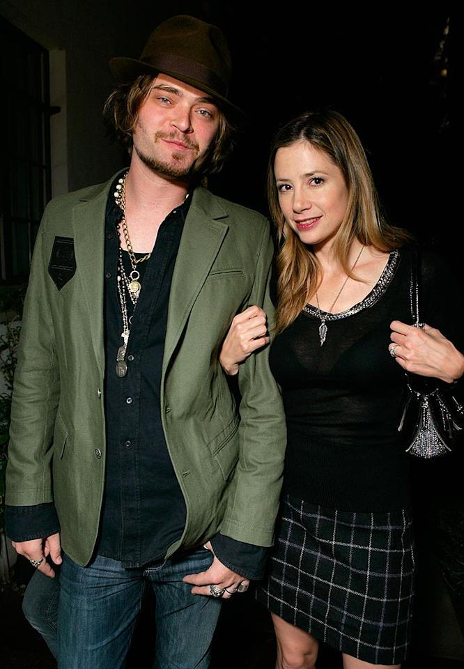 "Mira Sorvino and her husband Christopher Backus enjoy a rockin' night out on the town without their two kids. Todd Williamson/<a href=""http://www.wireimage.com"" target=""new"">WireImage.com</a> - October 19, 2007"