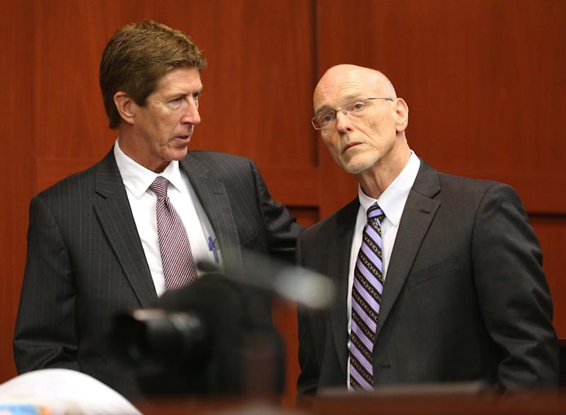 Defense attorney Mark O'Mara, left, confers with co-counsel Don West during the George Zimmerman trial in Seminole circuit court in Sanford, Fla., Wednesday, June 12, 2013. Zimmerman has been charged with second-degree murder for the 2012 shooting death of Trayvon Martin.(AP Photo/Orlando Sentinel, Joe Burbank, Pool)