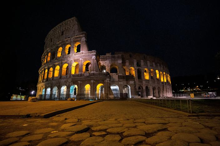 A view of the Colosseum in the evening in Rome.