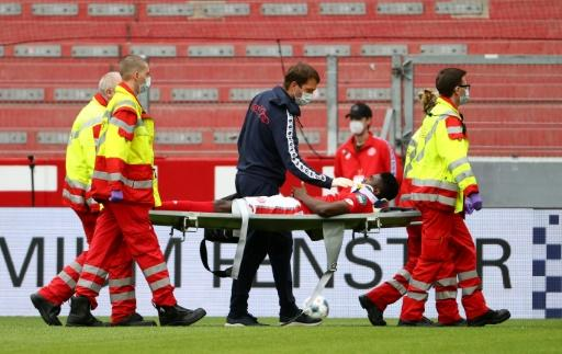 Mainz forward Taiwo Awoniyi is stretchered off after suffering a serious head injury in Sunday's relegation battle against Augsburg