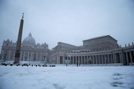 Saint Peter's Square is seen during a heavy snowfall early in the morning at the Vatican. REUTERS/Max Rossi