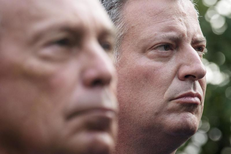 New York Mayoral candidate Bill de Blasio stands near New York Mayor Michael Bloomberg during the 9/11 Memorial ceremonies marking the 12th anniversary of the 9/11 attacks on the World Trade Center in New York