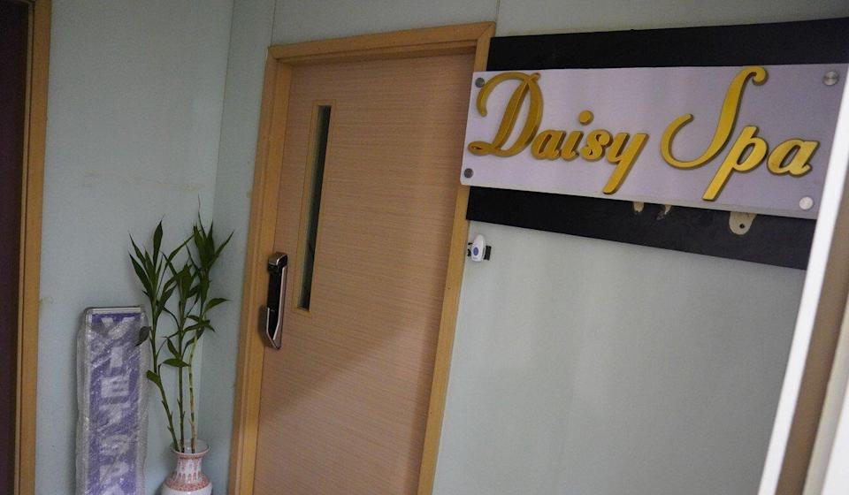 The massage parlour located inside Wan Chai's Senior Building recently changed its sign to Daisy Spa. Photo: Sam Tsang