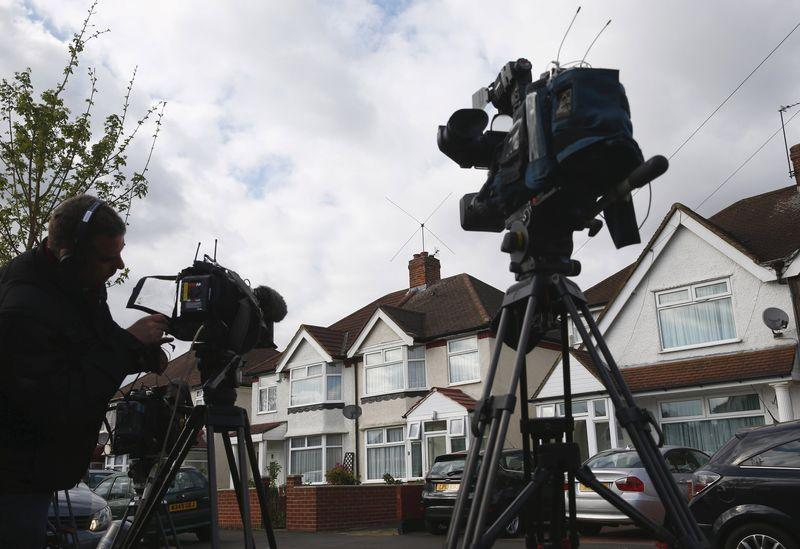 Television crews wait outside the address where Nav Sarao Futures Limited is registered, in Hounslow, London