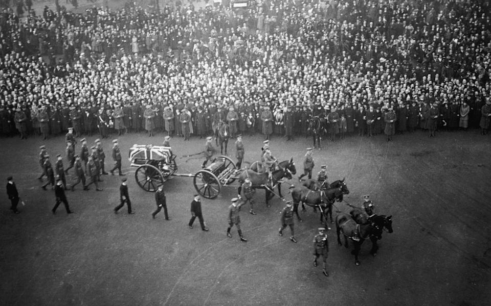 The coffin of the unknown warrior carried in procession through London in 1920 - Getty Images