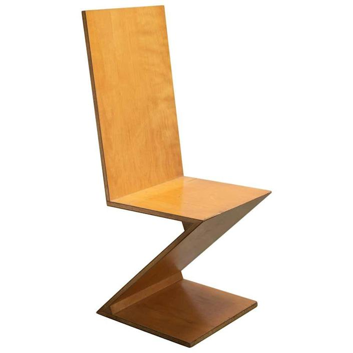 """<p><strong>Gerrit Rietveld</strong></p><p>1stdibs.com</p><p><a href=""""https://go.redirectingat.com?id=74968X1596630&url=https%3A%2F%2Fwww.1stdibs.com%2Ffurniture%2Fseating%2Fchairs%2Fzig-zag-chair-designed-gerrit-rietveld-elm-circa-1960-netherlands-europe%2Fid-f_13244691%2F&sref=https%3A%2F%2Fwww.redbookmag.com%2Fbeauty%2Fg37132432%2Fchair-types-styles-designs%2F"""" rel=""""nofollow noopener"""" target=""""_blank"""" data-ylk=""""slk:Shop Now"""" class=""""link rapid-noclick-resp"""">Shop Now</a></p><p>""""It is not a chair but a designer's joke"""" is how Dutch designer Gerrit Rietveld described his Zig Zag chair, created in 1934 for a Dutch Department store in search of a design that could be easily mass-produced. Rietveld's creating is stunningly simple, comprised of just four pieces of wood for a striking silhouette. The chair is now produced by <a href=""""https://www.cassina.com/en/collection/chairs/280-zig-zag"""" rel=""""nofollow noopener"""" target=""""_blank"""" data-ylk=""""slk:Cassina."""" class=""""link rapid-noclick-resp"""">Cassina.</a></p>"""