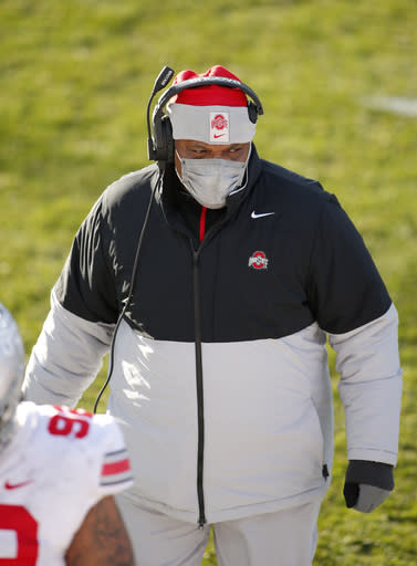 Ohio State interim head coach Larry Johnson looks on during the second half of an NCAA college football game against Michigan State, Saturday, Dec. 5, 2020, in East Lansing, Mich. (AP Photo/Al Goldis)
