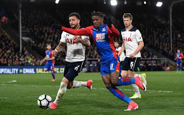 Wilfried Zaha in action against Tottenham last month - REUTERS