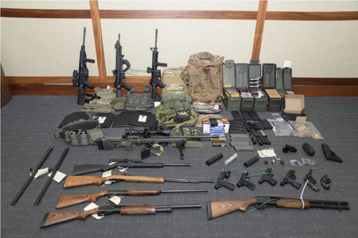 A photo of firearms and ammunition that belonged to Christopher Paul Hasson, a Coast Guard lieutenant. (Maryland U.S. District Attorney's Office via AP)