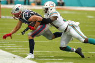 Miami Dolphins defensive back Ken Webster (31) tackles New England Patriots wide receiver Julian Edelman (11), during the first half at an NFL football game, Sunday, Sept. 15, 2019, in Miami Gardens, Fla. (AP Photo/Wilfredo Lee)