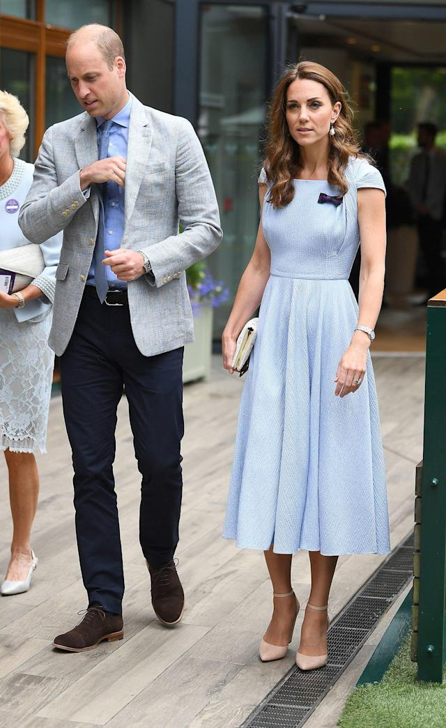 Kate wore a custom light blue dress with a purple bow detail by Emilia Wickstead for a day date with Prince William at Wimbledon in July.