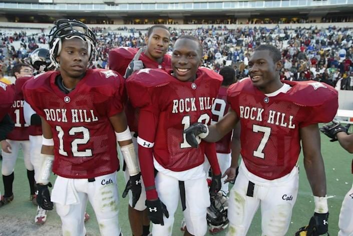 Phillip Adams, center, is surrounded by teammates Devin Ware, left, Ladarious Moore, right, and Tori Gurley, behind, as they celebrate winning the Big 16 state championship against Stratford in 2004.