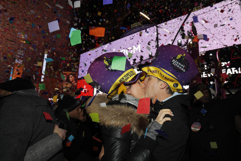 Sandra Desjardins kisses Jean-Charles Goulet both of Montreal, Canada, during a New Year's celebration in New York's Times Square, Wednesday, Jan. 1, 2020. (AP Photo/Adam Hunger)