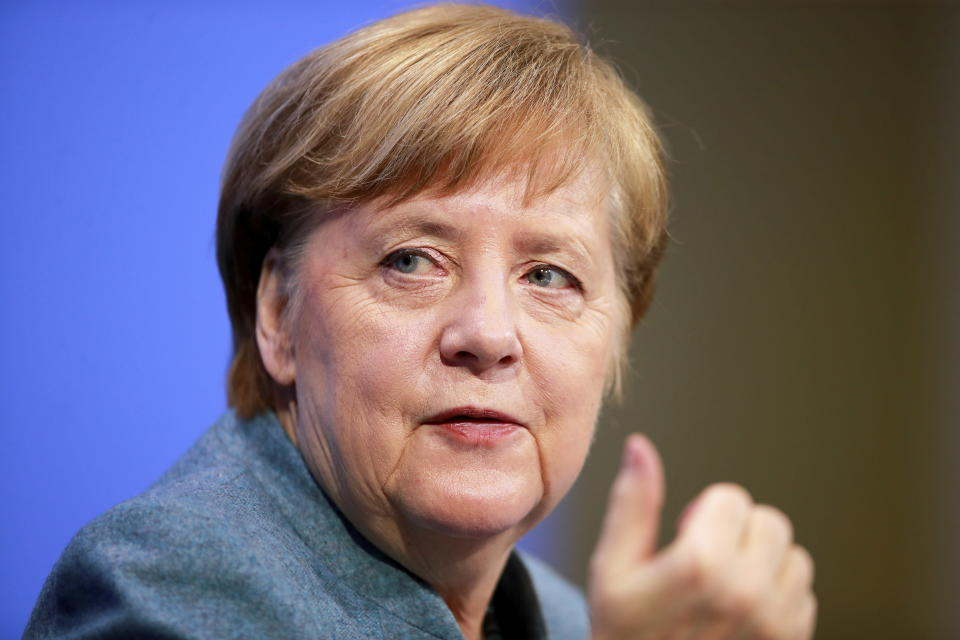 German Chancellor Angela Merkel holds a news conference after meeting with vaccine producers and Germany's state prime ministers via video conference, in Berlin, Germany, Monday Feb. 1, 2021. (Hannibal Hanschke/Pool via AP)