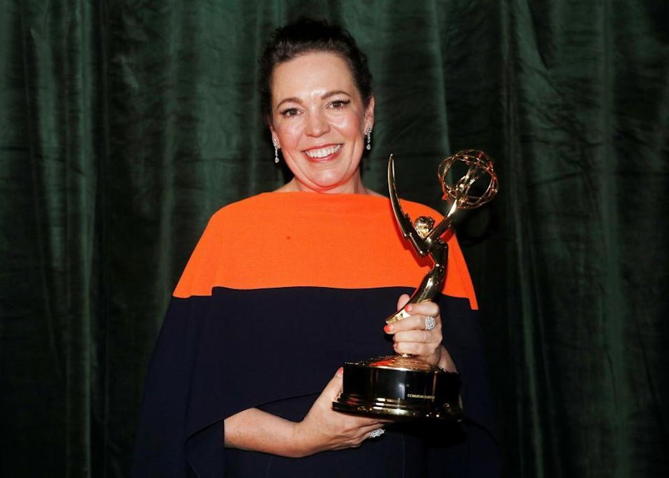Olivia Colman poses with her Emmy award.