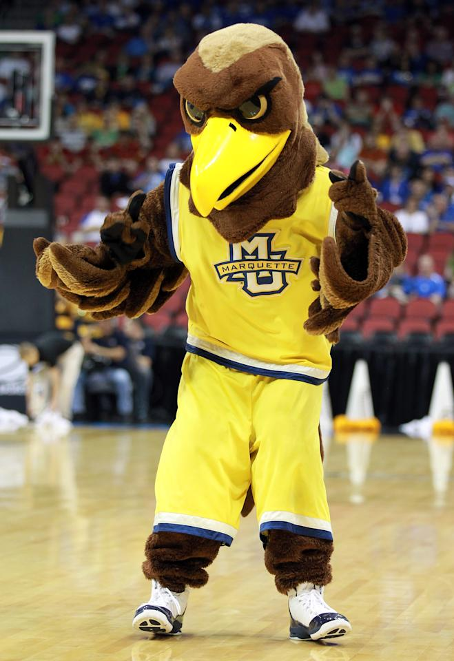 LOUISVILLE, KY - MARCH 17:  The Marquette Golden Eagles mascot performs on the court during a break in the game against the Murray State Racers during the third round of the 2012 NCAA Men's Basketball Tournament at KFC YUM! Center on March 15, 2012 in Louisville, Kentucky.  (Photo by Andy Lyons/Getty Images)