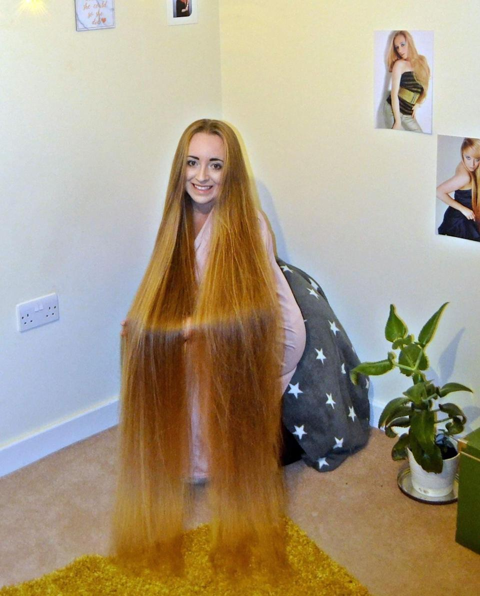 The computing student says men love her long locks. (Caters)