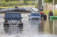 In Kirkliston, West Lothian, emergency services had to rescue drivers from floodwater. (SWNS)