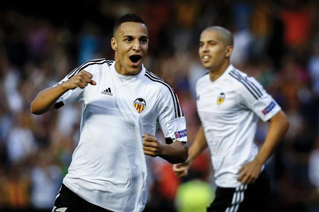 Valencia's Brazilian Forward Rodrigo Moreno (L) celebrates after scoring during the UEFA Champions League playoff football match between Valencia CF vs AS Monaco FC at the Mestalla stadium in Valencia on August 19, 2014. AFP PHOTO/ BIEL ALINO (AFP Photo/Biel Alino)