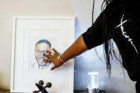 In this July 8, 2021, photo Latrice Felix whose son Alan Womack Jr. was was killed in 2020 during a fight, touches an image of him during an interview with The Associated Press in King of Prussia, Pa. (AP Photo/Matt Rourke)