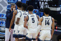 Villanova head coach Jay Wright greets his players as they are taken out during the second half of a second-round game against North Texas in the NCAA men's college basketball tournament at Bankers Life Fieldhouse, Sunday, March 21, 2021, in Indianapolis. Villanova won 84-61. (AP Photo/Darron Cummings)