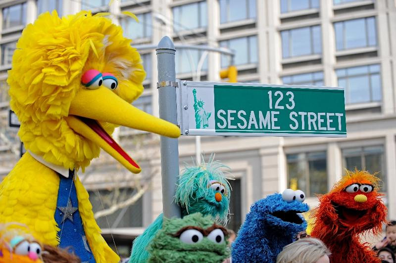 Big Bird (L) and other Sesame Street puppet charactors will be joined by a new muppet named Julia who has autism