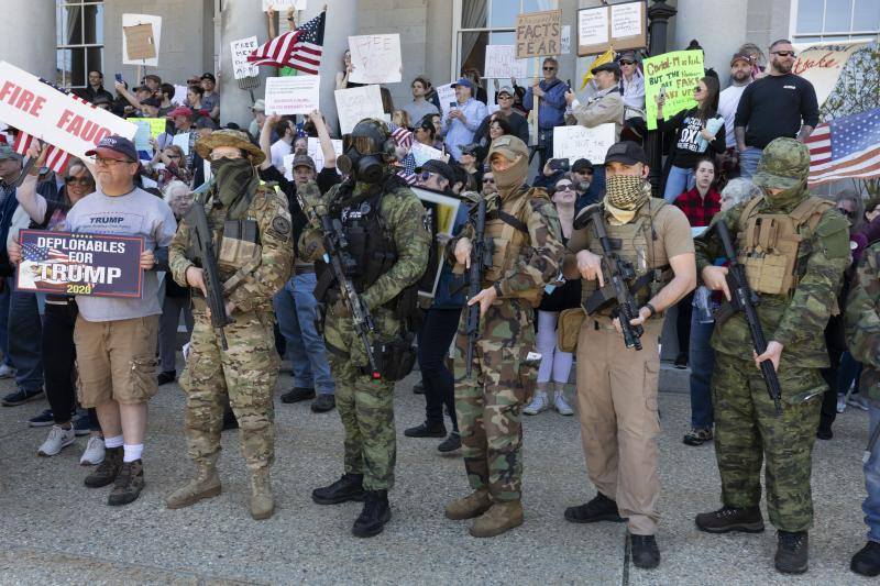 People, including those with the boogaloo movement, demonstrate against business closures due to concern about COVID-19, at the State House in Concord, N.H. on May 2, 2020. (Michael Dwyer/AP File)