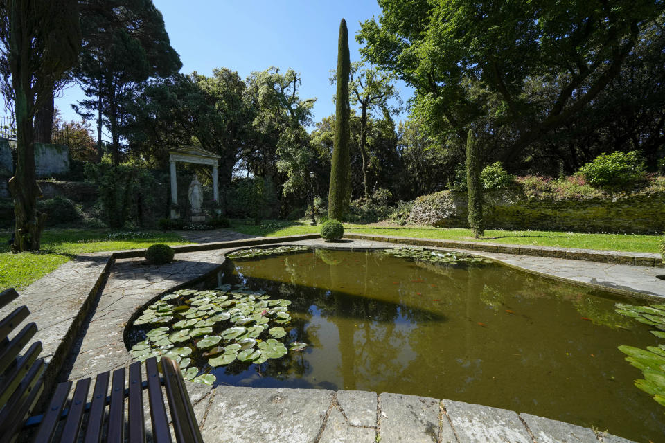 A view of the pond with a statue of the Madonna where Pope John Paul II used to gather in prayer in the gardens of the Papal Palace in Castel Gandolfo, some 30 kilometers southeast of Rome, Saturday, May 29, 2021. As Covid-19 restrictions are slowly being lifted in Italy, thousands of people are returning to visit the extensive gardens and apartments at the Papal Palace of Castel Gandolfo in the Alban Hills near Rome, that for hundreds of years have been the summer retreat for Popes seeking to escape the suffocating heat of Rome. (AP Photo/Andrew Medichini)