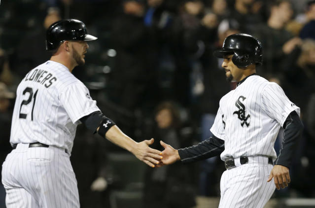 Chicago White Sox's Tyler Flowers, left, and Marcus Semien celebrate after scoring off a double by Adam Eaton, on a pitch by Tampa Bay Rays relief pitcher Jake McGee, during the sixth inning of a baseball game Monday, April 28, 2014, in Chicago. (AP Photo/Charles Rex Arbogast)
